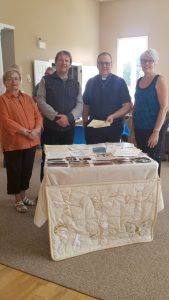 Churchwarden Reta Craig, Pastor Owen Ash, Canon Terry DeForest and Churchwarden Laurie Douglas were on hand to see what the pioneers of the past had sealed away in a capsule for the pioneers of today. Photo: Submitted by Laurie Douglas