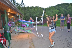 Making giant bubbles: the young people had fun seeing who could get the largest bubble. Photo: diocesan website