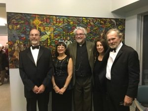 """The group"" from Song of the Grand poses in front of the mural at Christ Church Flamborough (left to right): pianist and vocals Brahm Goldhamer, soprano Elizabeth Niec, narrator Canon Robert Brownlie, co-ordinator Susan Hall with writer, composer and vocalist George Hall.Photo: Submitted"