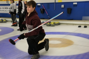 Ben De Winter from Burlington showed great flair playing in his first game of curling.