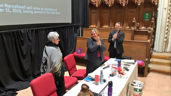 The Reverend Canon Marni Nancekivell modelled the Indigenous diversity blanket presented to her following a synod motion acknowledging her many ...